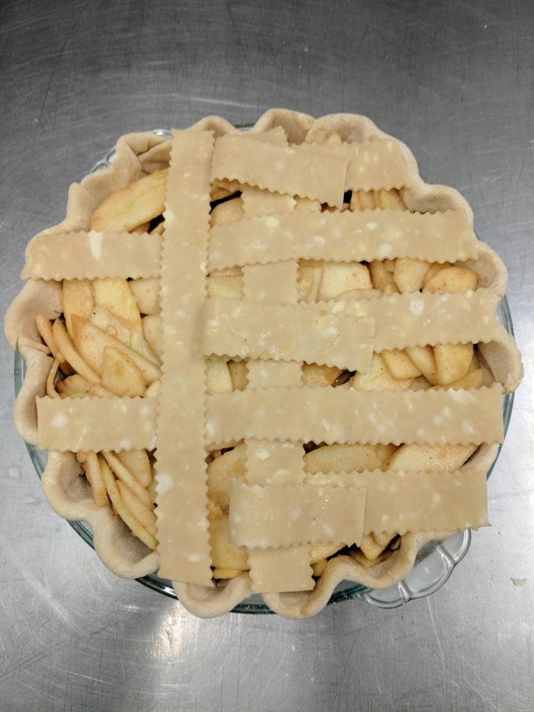 Learning how to do latice work on an apple pie