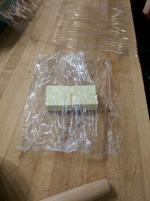Double wrap the four sticks of butter to prepare a slight punding and rolling technique.