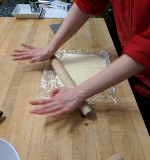 Gently roll the butter to form a square.