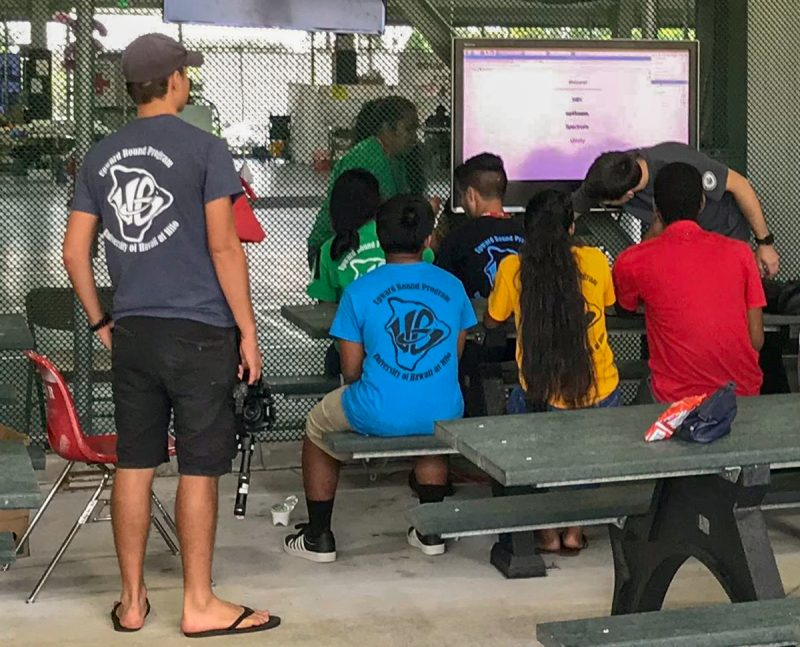 Students from the Teaching Through Technology (T3) Alliance, University of Hawai'i Hilo Upward Bound summer program, install an air-quality monitoring station outside the Dragon's Eye Learning Center on Papaya Farms Road. Photo courtesy of Adam Low, T3 Alliance.