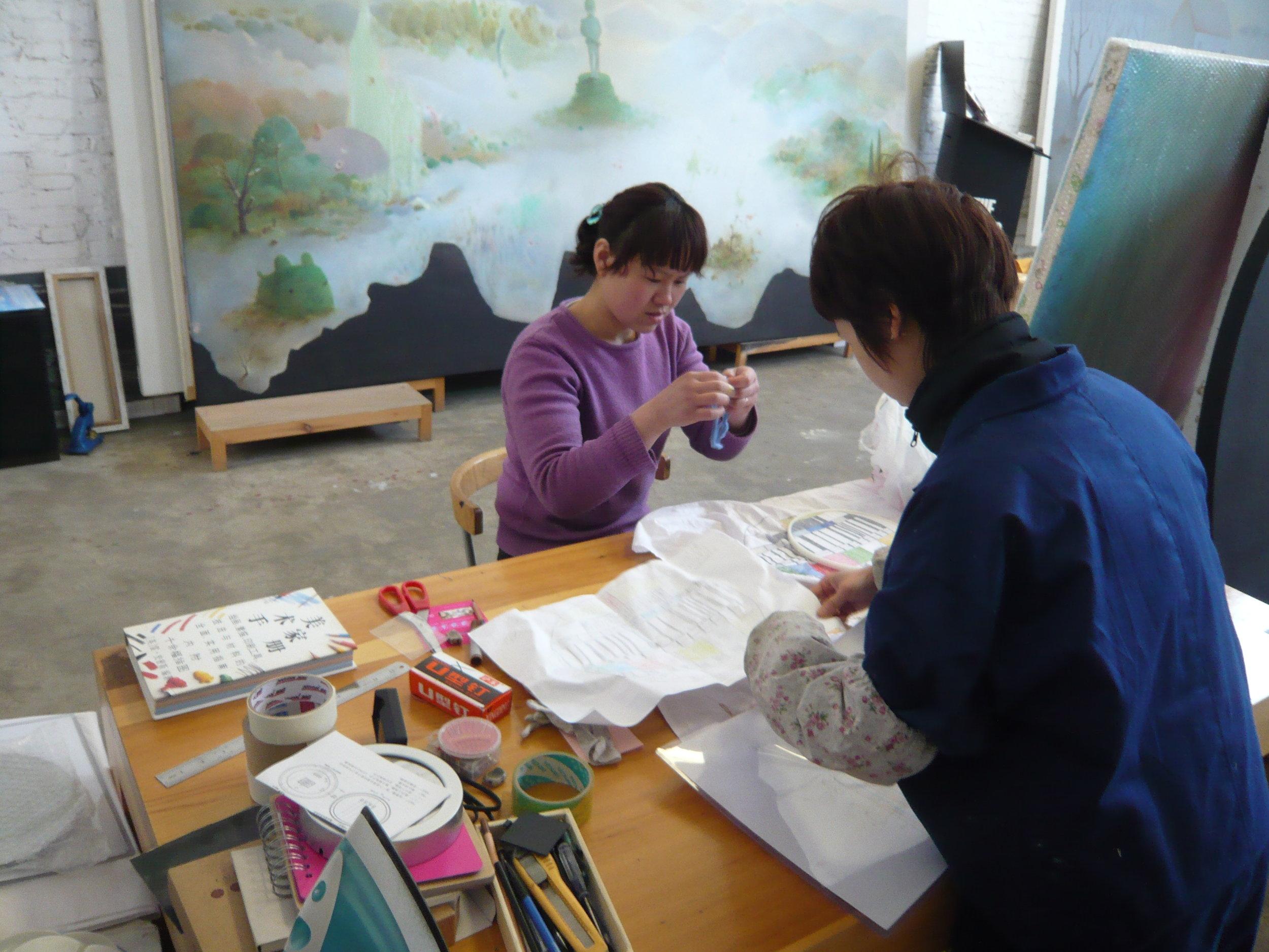 meeting in the artist's studio