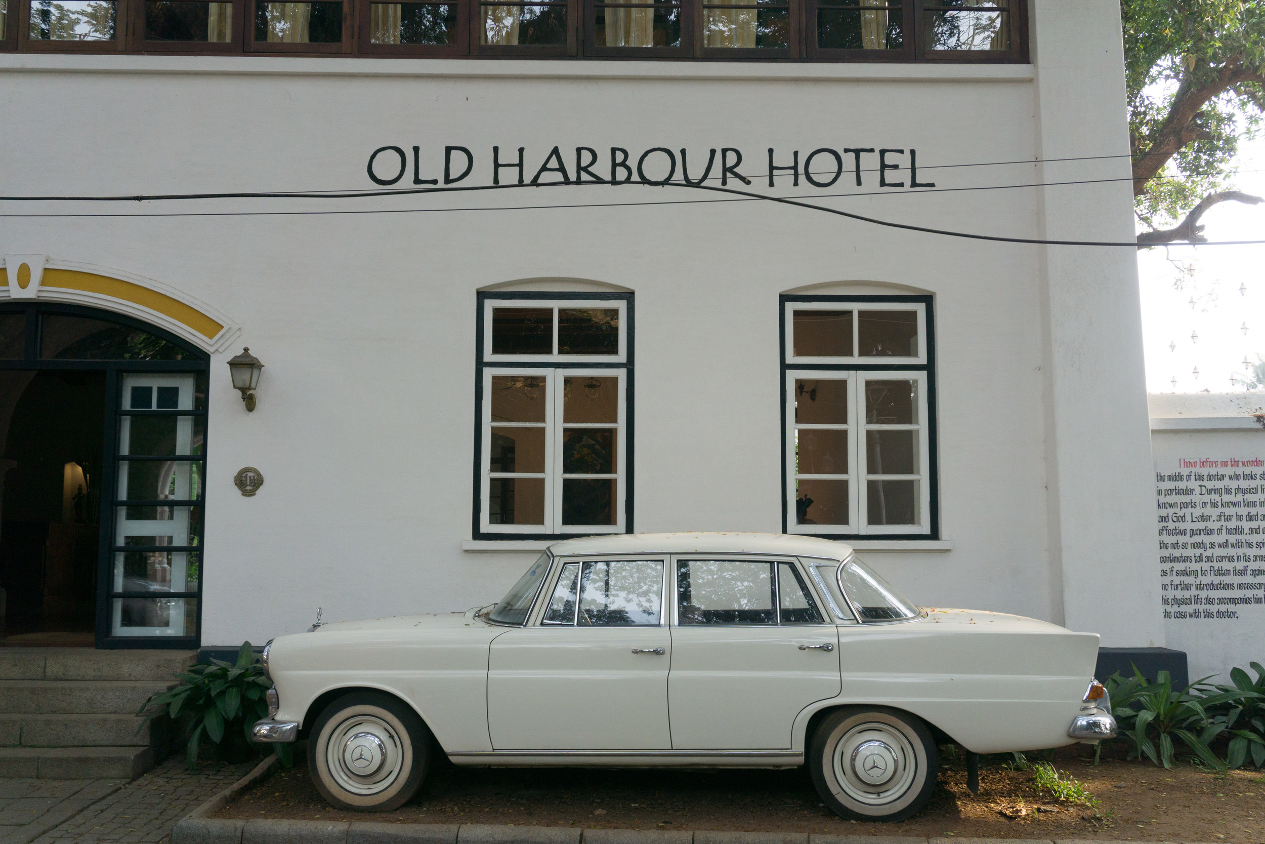 An Indian classic car, the Ambassador, outside the Old Harbour Hotel