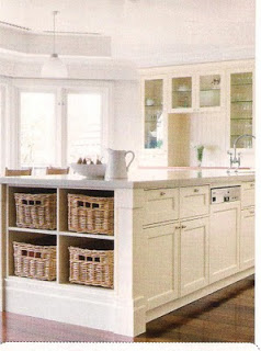 Basket combinations on the end of cabinets makes it easy to access and looks good.   PHOTO CREDIT: PINTEREST