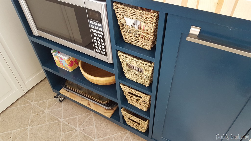 Here the microwave is not built in but loosely placed in the cubby   PHOTO CREDIT: REALITY DAYDREAM