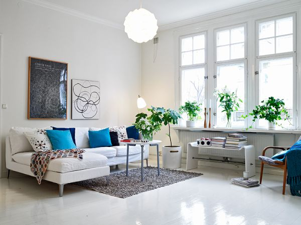 """- This White Color Palette can easily be created in a condo scenario. IKEA style scandinavian furniture can easily keep the cost low and some bright color pops is all that is needed to tell your story.Picture Courtesy """"homedit"""" - Interior Design & Architecture"""