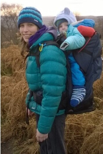 Jo out for a climb with baby Ollie, who is all wrapped up in lots of layer.