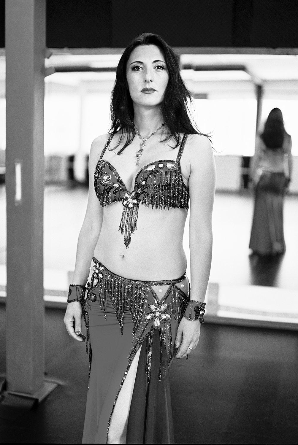 "Ana // Owner belly dance studio Ana Danst ""If you want to learn how to belly dance, you'll be a 'beginner' for the first few years. If you're here for some 'quick tricks', you're at the wrong address"", she said with friendly conviction. She didn't seem too worried about scaring off the new students. It made me smile and it got me curious. 5/10"