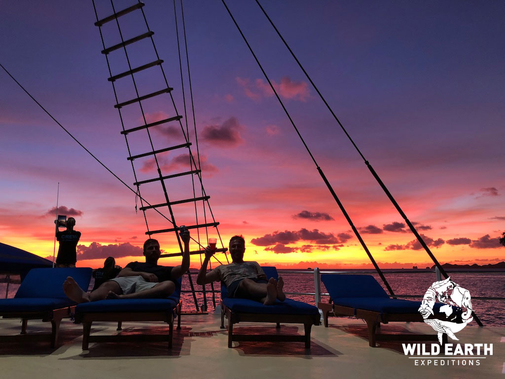 'chilling' on the deck at sunset - Palau - Wild Earth Expeditions