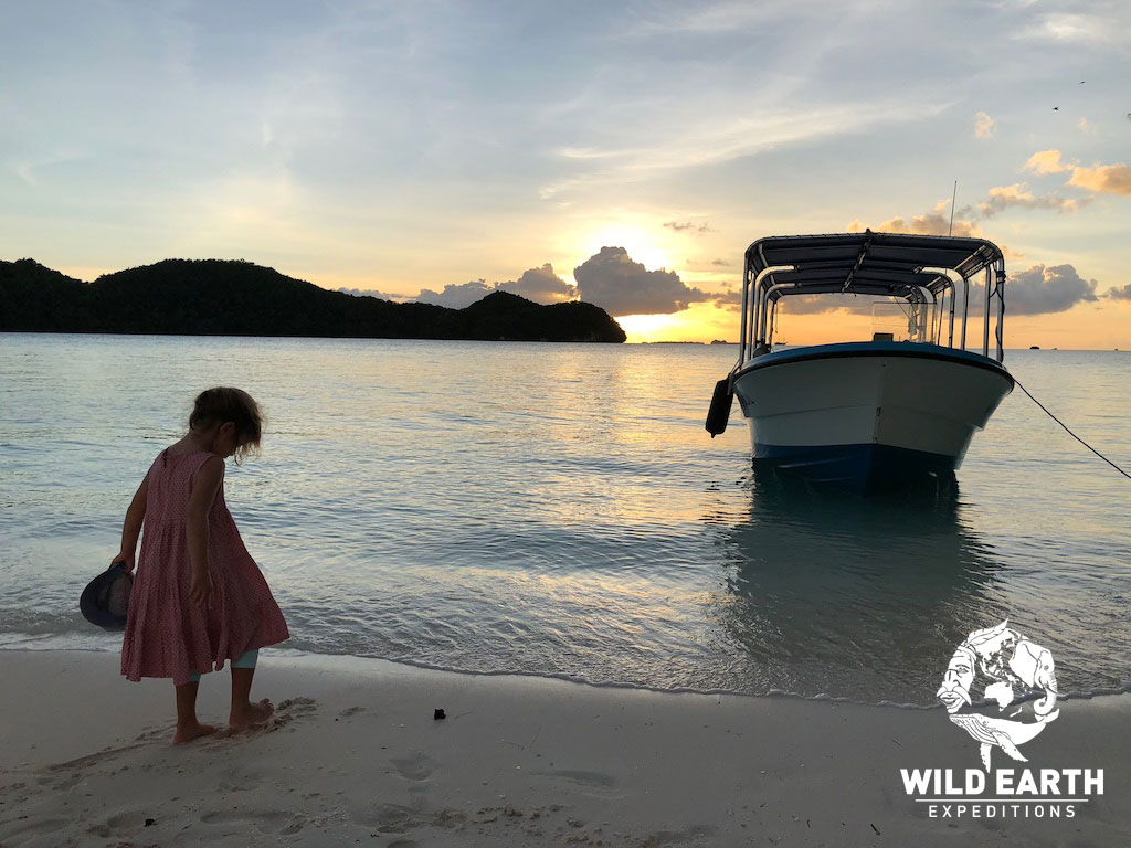 Coco paddles as the sunsets - Palau - Wild Earth Expeditions