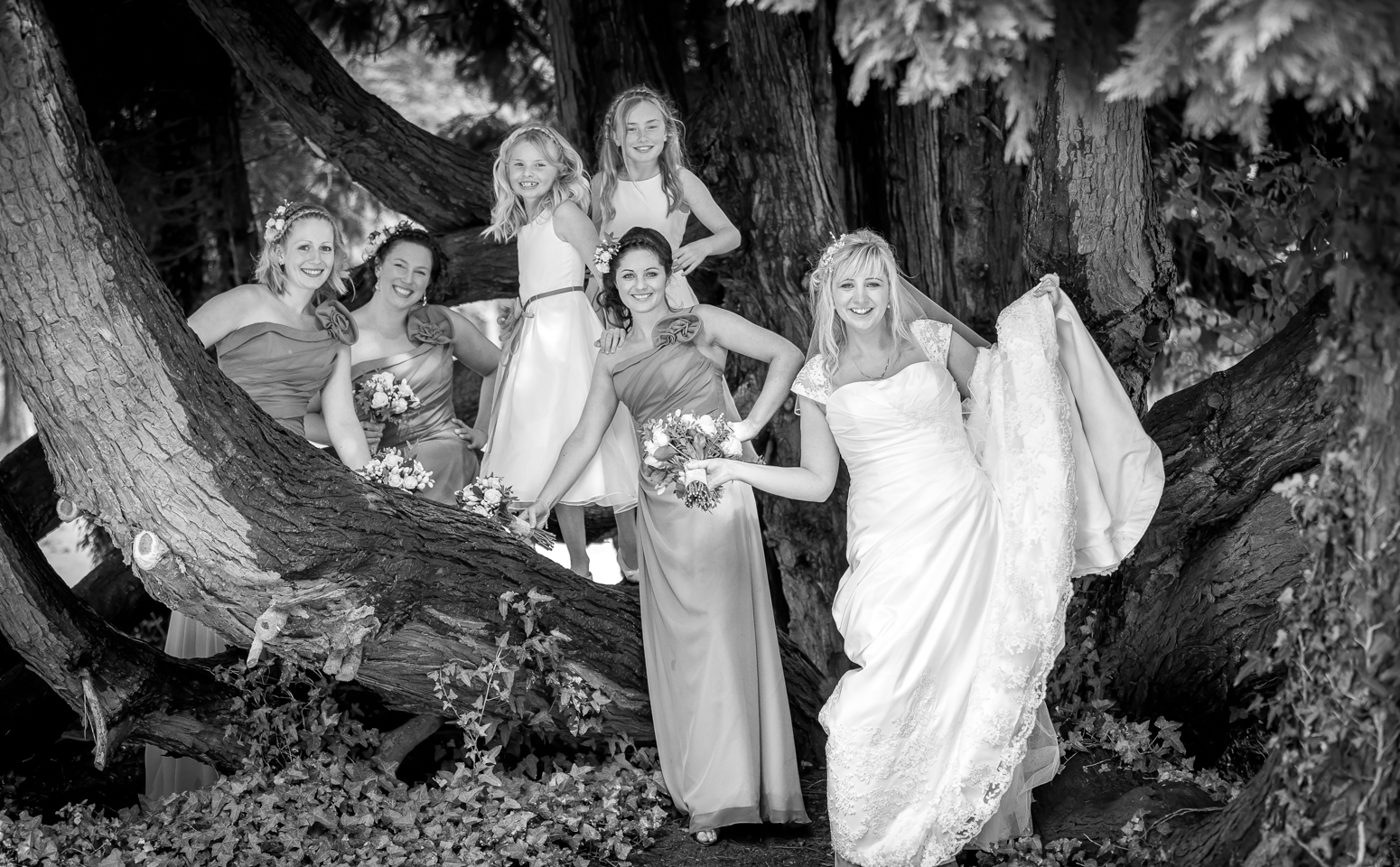 Bridesmaids having fun Coed-Y-Mwstwr wedding