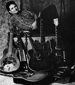 Patrick Rouchon – June, 14 1989 – Spencer and his guitars. Paris, France