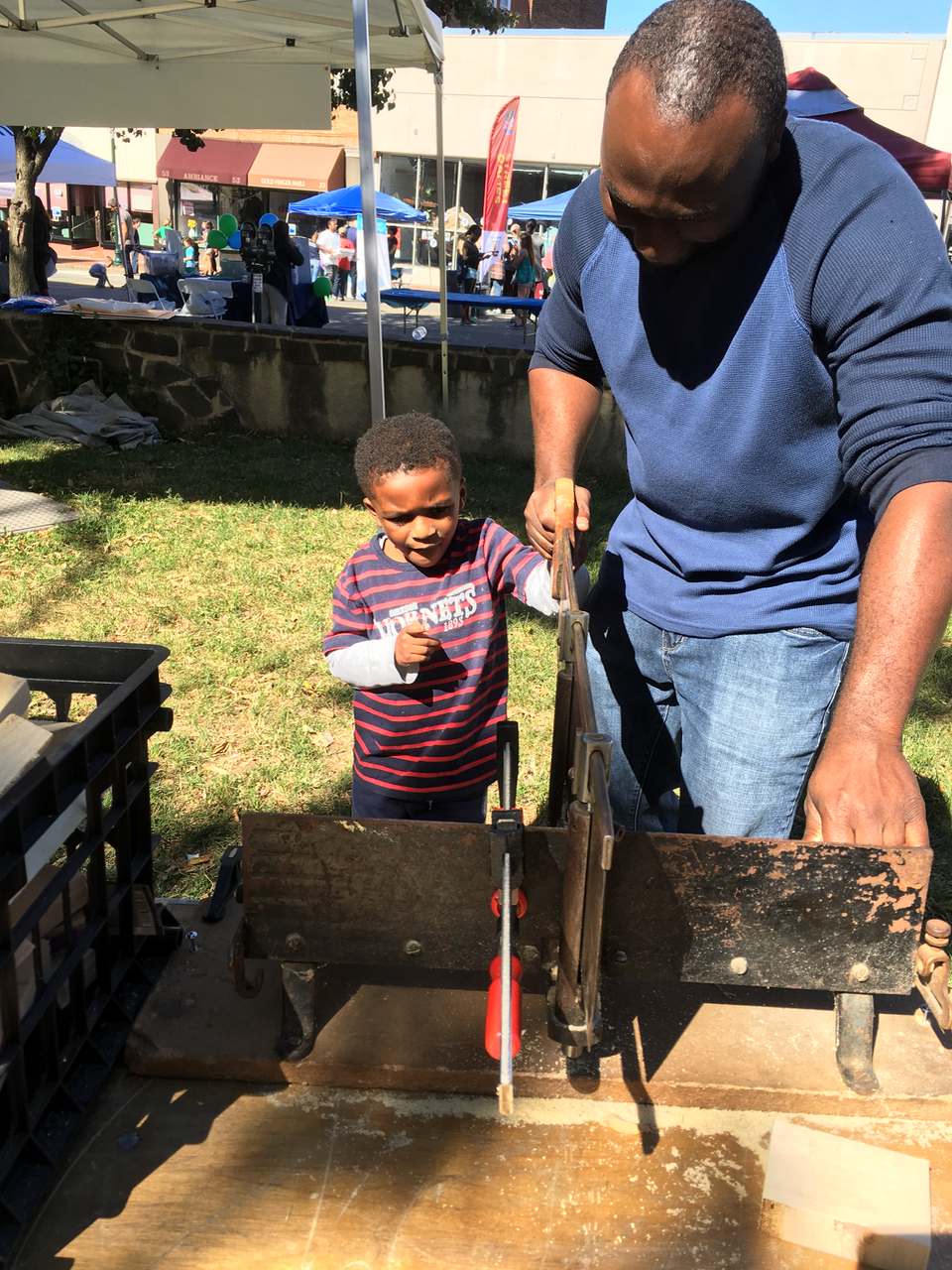 Community - SO Play Day Dad and Son sawing.png