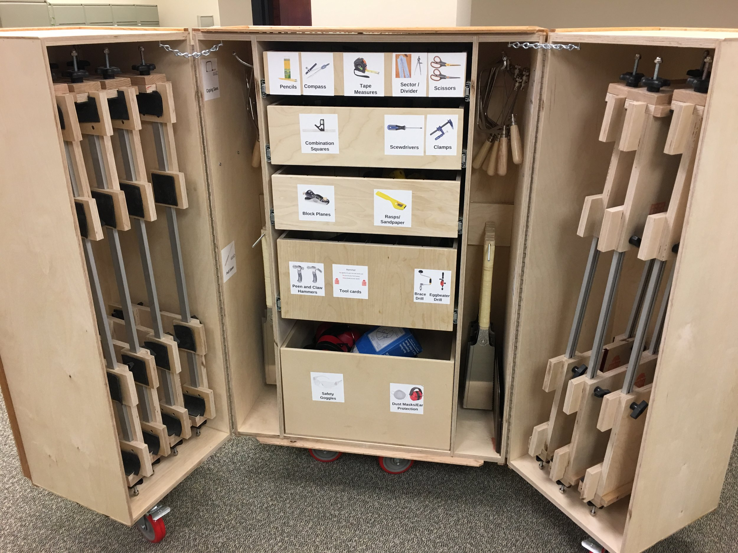 The Toolbox with hand tools and table top workstations - Our custom, portable, lockable toolbox has everything you need to easily and successfully implement woodworking into your school today!