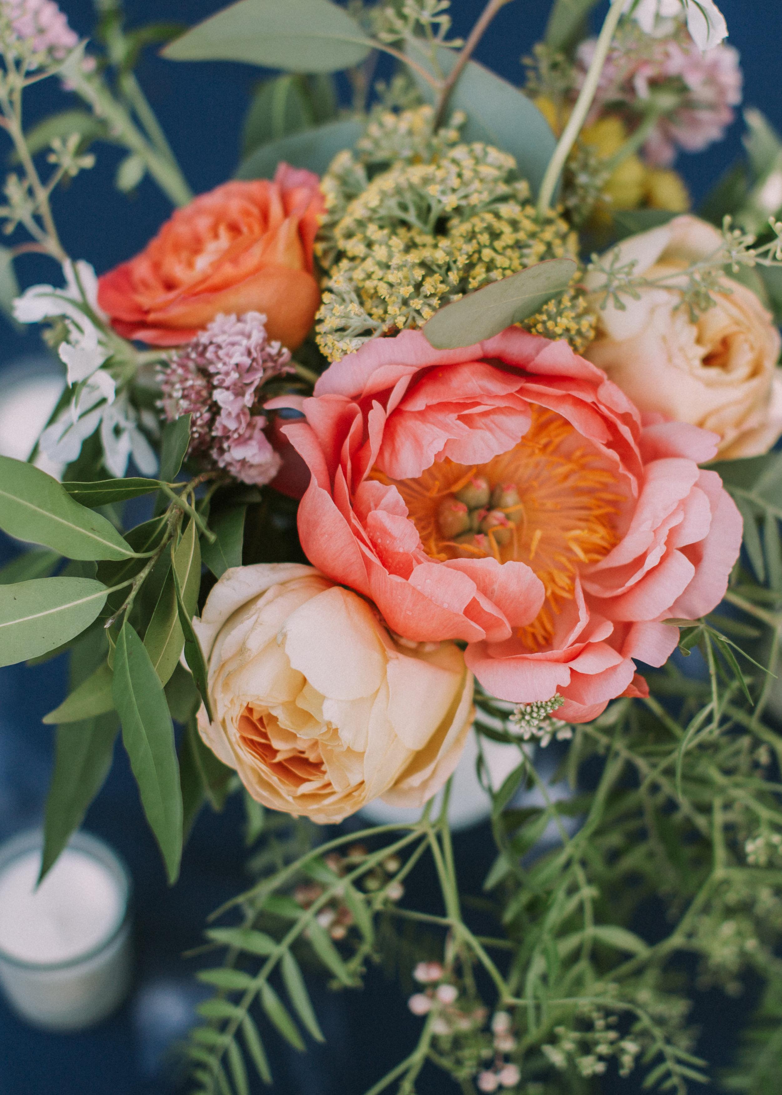 CarlaAndJacob_Wedding_Coral-Peony-on-navy-tablecloth.jpg