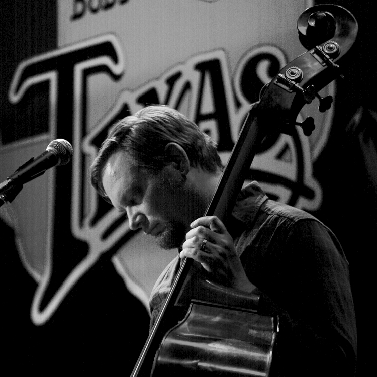 Kurt Ciesla - BassA gifted performer and burgeoning composer, Kurt is a unique voice in the music world. His career spans over two decades and encompasses many genres such as jazz, country, funk, and blues. As the longest running band member with Corb Lund, his versatility and creativity have helped Corb's music resonate across genres.Treating the bass as a solo instrument rather than just rhythmic support, Kurt has toured the world to regale crowds large and small with his distinct brand of music. Whether he is slapping, bowing, or simply laying it down, Ciesla is sure to delight.