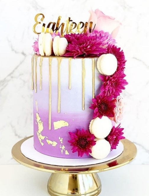 """8"""" Gold Drip Cake with Florals and additional gold leaf and Macarons"""