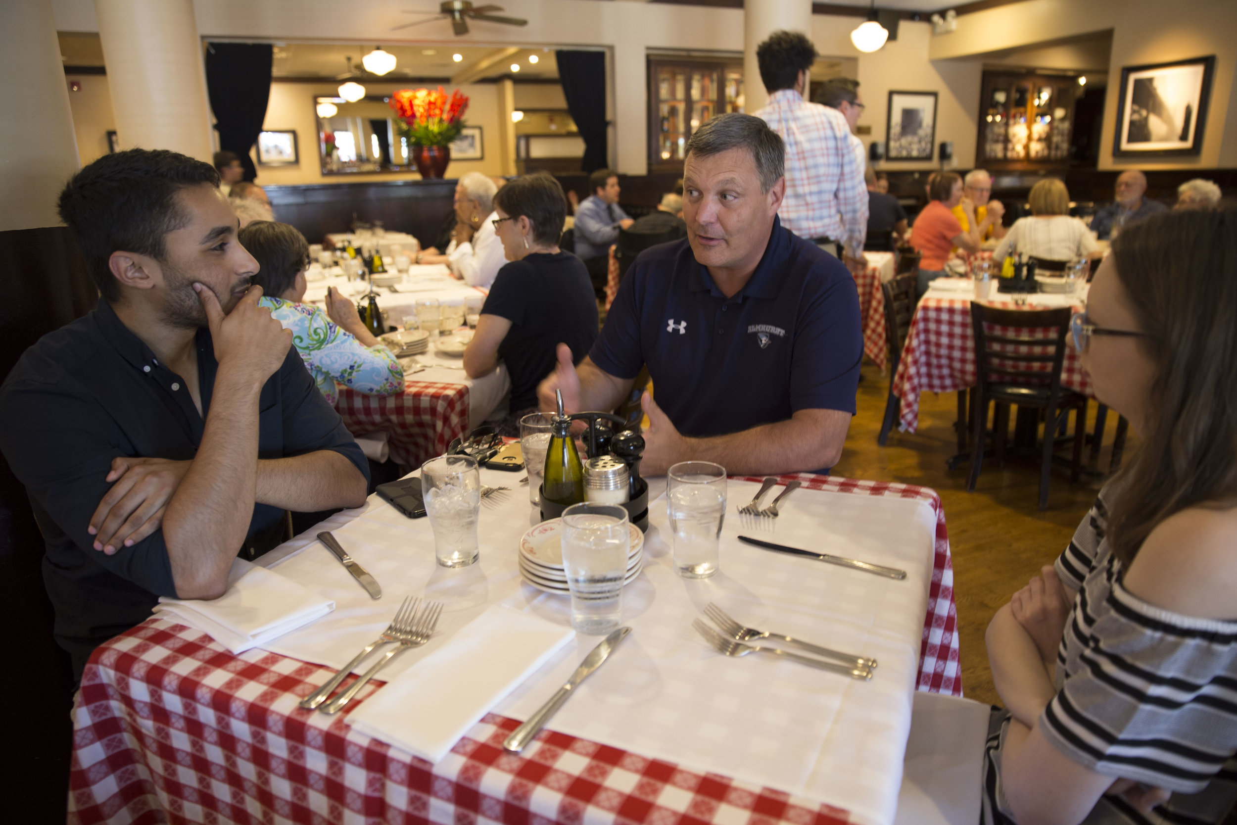 EC President Troy VanAken (middle) discusses his first year as EC's president with Leader Editor-in-Chief Kenneth Edison (left) and News Editor Victoria Martin at Maggiano's in Oak Brook on Tuesday, July 25.  Photo by Marielle Decena