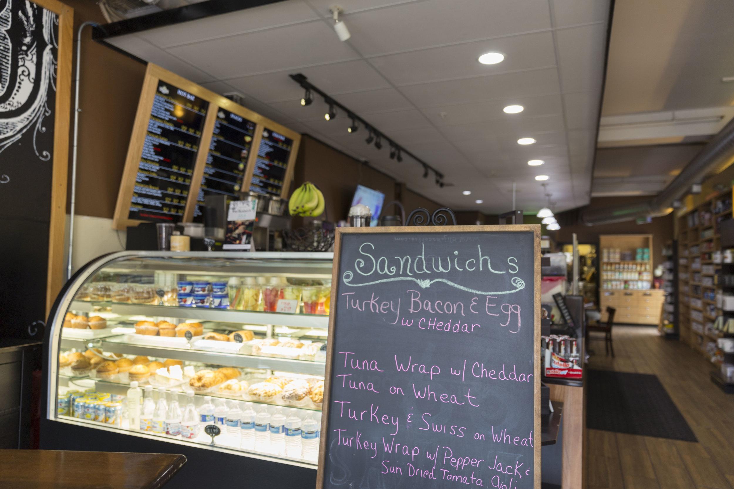 Photo by Marielle Decena   Gloria Jean's chalkboard menu advertises the various sandwich and breakfast options.