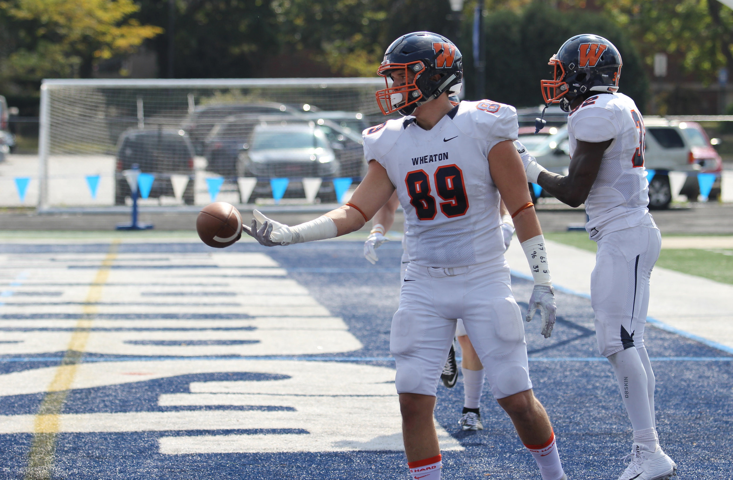 A Wheaton College football player displays the numbers of players recently indicted for 2016 hazing accusations.  Photo by Cole Sheeks