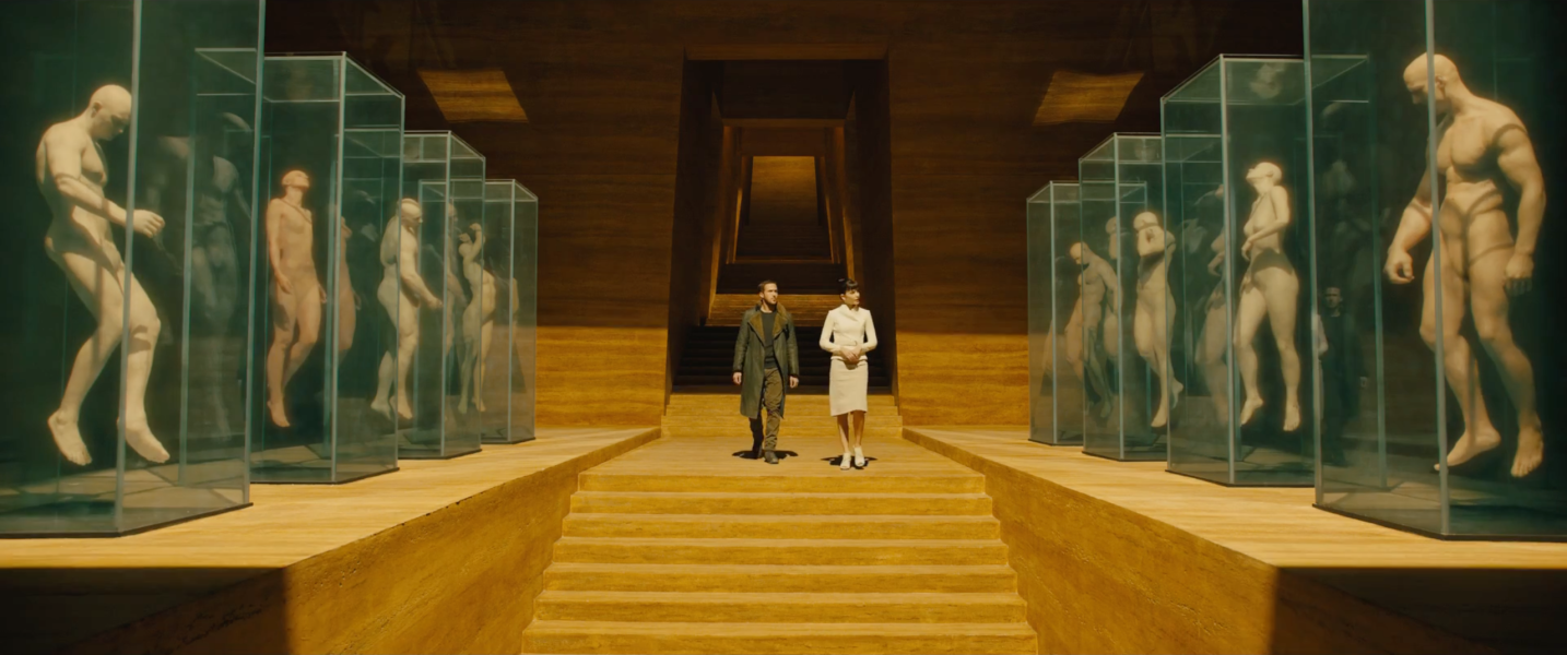 """Main character 'K', (Ryan Gosling) is taken through the mass production center where replicants are made in """"Blade Runner 2049"""" now in theaters."""