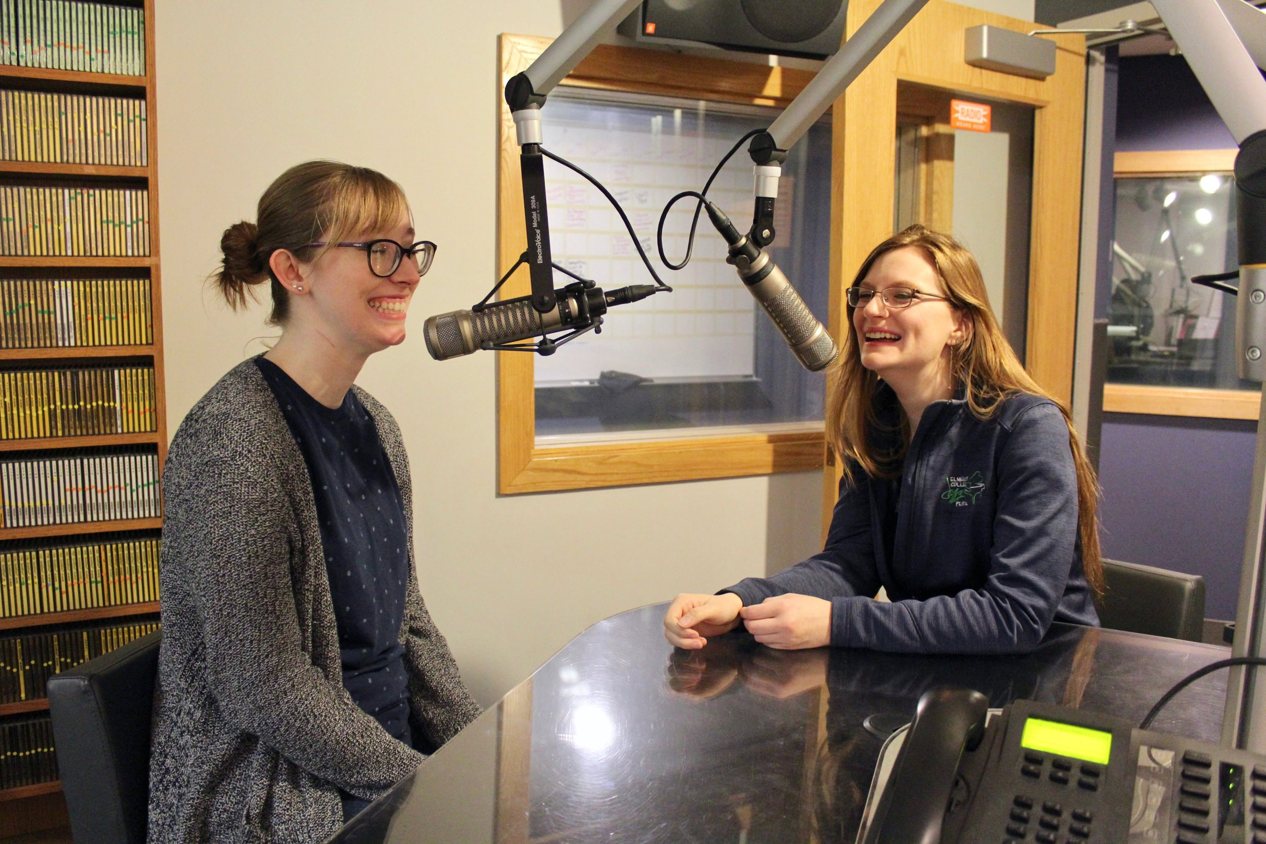 Photo by Abby Robb   EC seniors Jen Anthony (left) and Emma Kaminski practice for their upcoming attempt at beating the world record for longest talk radio show.