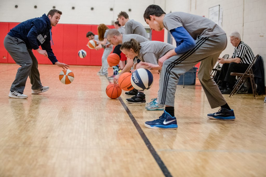 Assistant coach for Bluejays men's basketball Peyton Wyatt helps young athletes from Access Sports learn sportsmanship and teamwork while playing basketball.  Photo courtesy of Access Sports