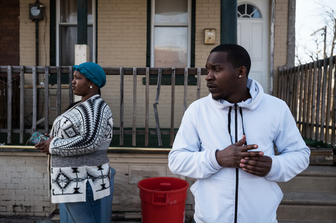 Brittany Gilmore, left, and Charles Chapman in North Camden, near a corner where two of Ms. Gilmore's relatives were killed in 2011. Credit Todd Heisler/The New York Times