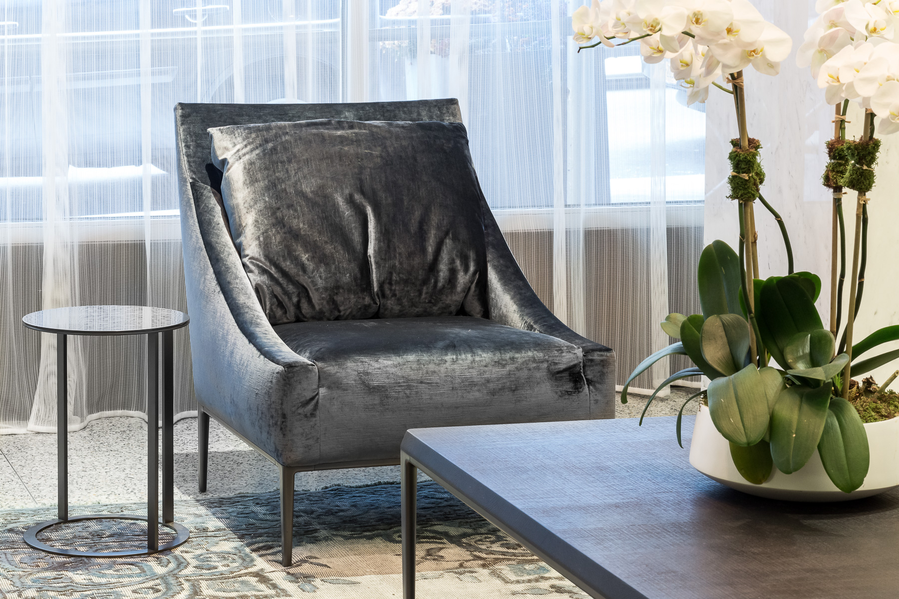 The sumptuous velvet of these lounge chairs provide a surface that's just begging to be sat upon. They also juxtapose with the vintage rug that we chose for this room, you can also read more on our  tips for selecting the perfect rug !