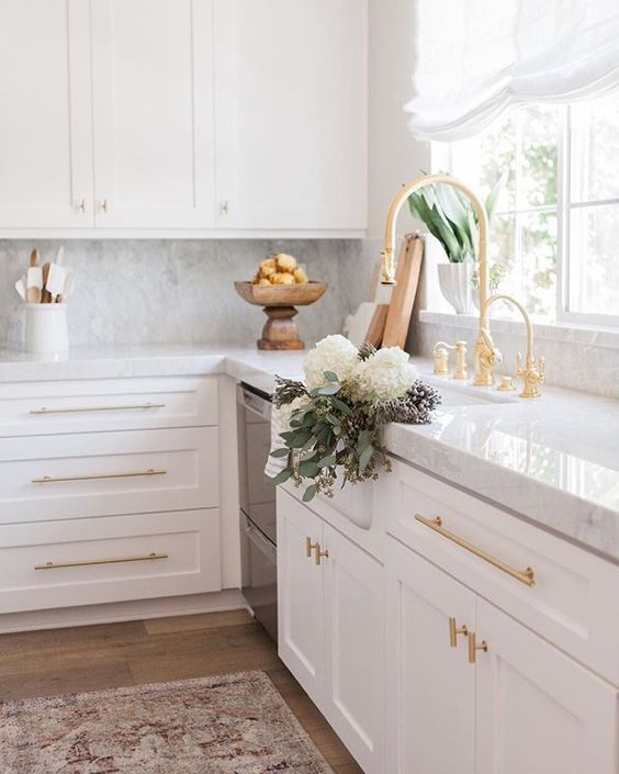 Brass hardware and faucet add character and sophistication to the kitchen