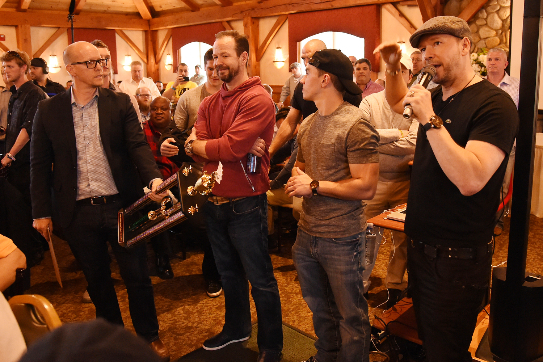 Jim, Bob, Brandon and Donnie unveil the 2016 MWYF Celebrity Poker Tournament Trophy
