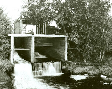 The Mill Race flowing through an early wooden culvert. (Photo courtesy of the Springfield Museum)