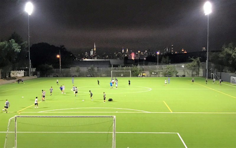 Make It A Metropolitan Night - Exciting Manhattan skyline provides the perfect backdrop for youth soccer players at MetOval's new non-infill turf field instilled at its Youth Center of Excellence.