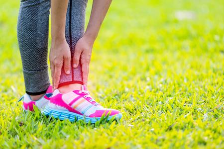 75711317_S_foot_pain_girl_sneakers_leg_hand_gripping_grass.jpg