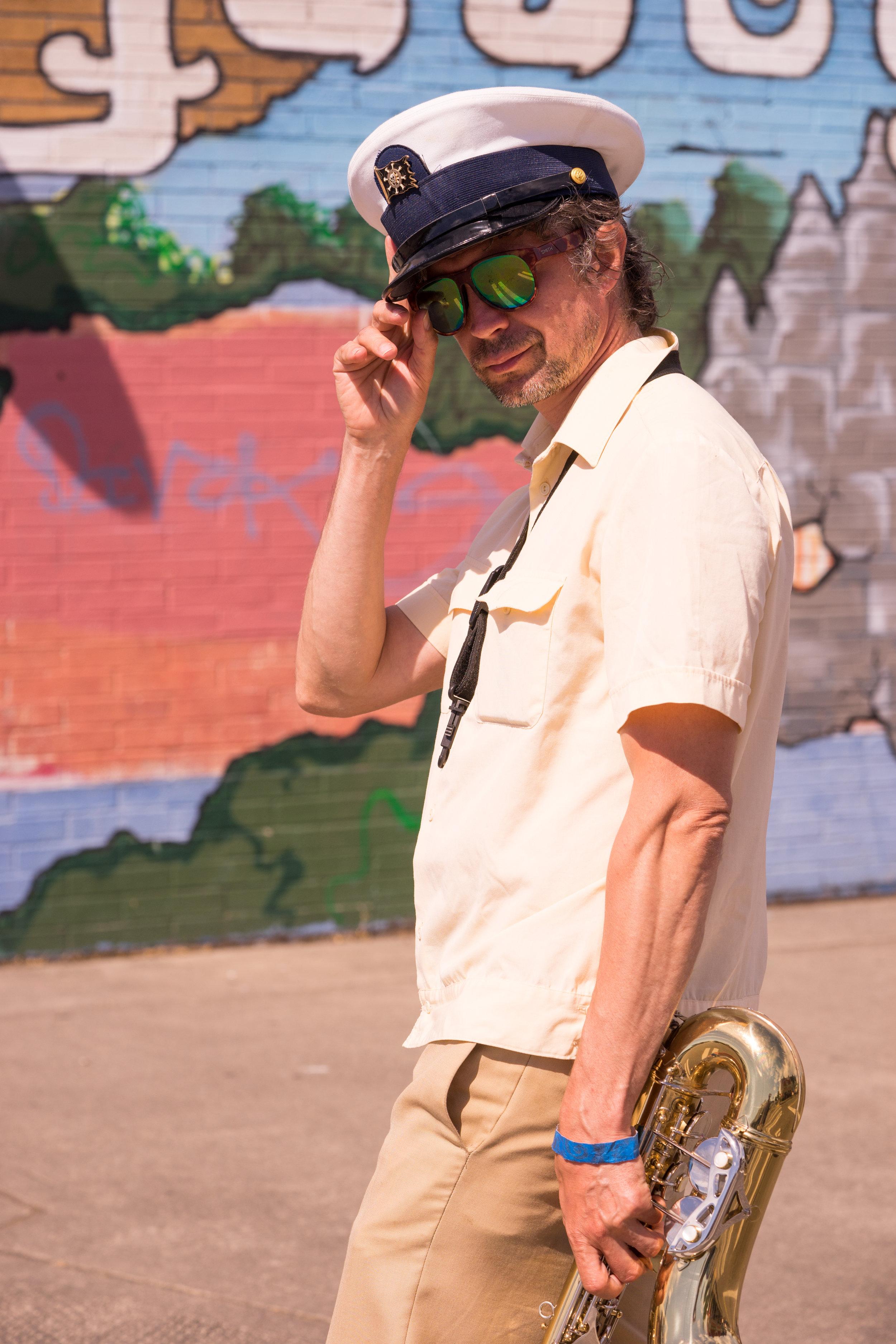 Horn Player outside Angkor Market