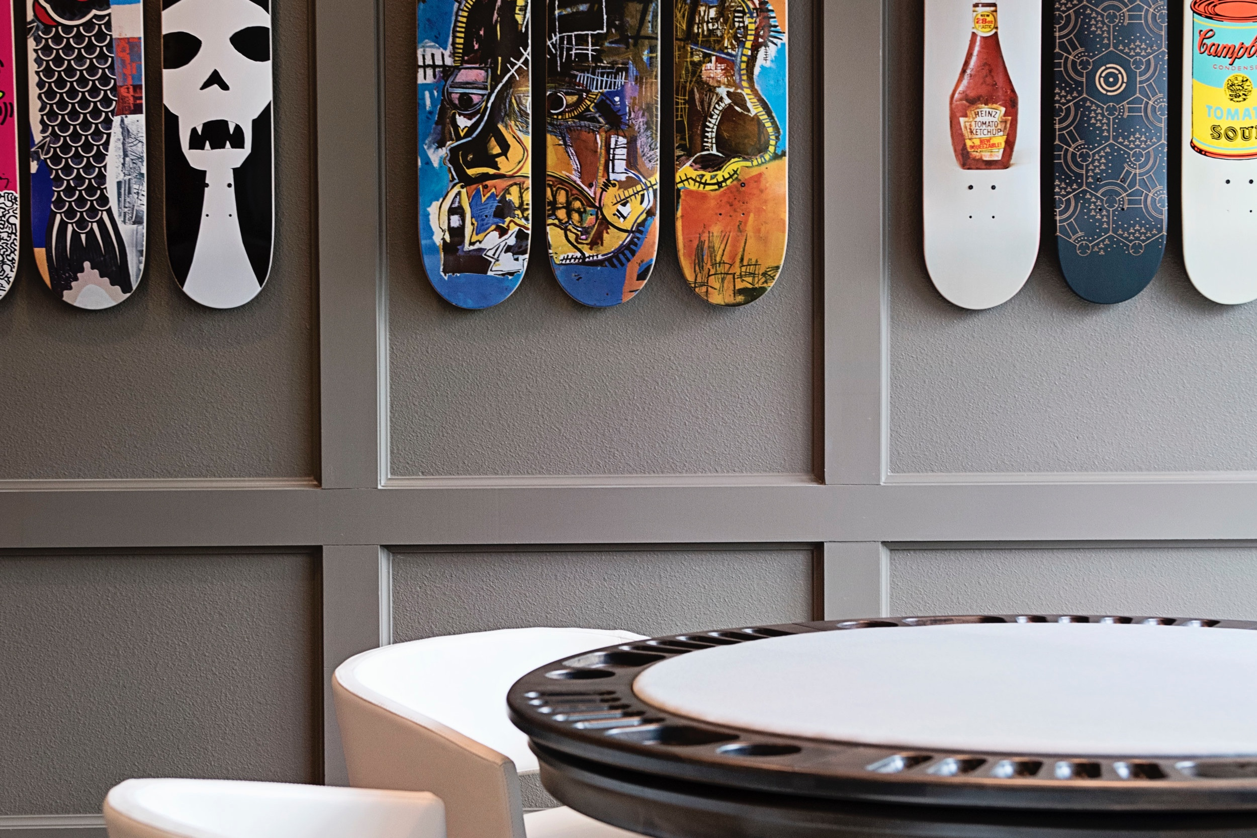 skateboard display in Arcos Apartment's game room