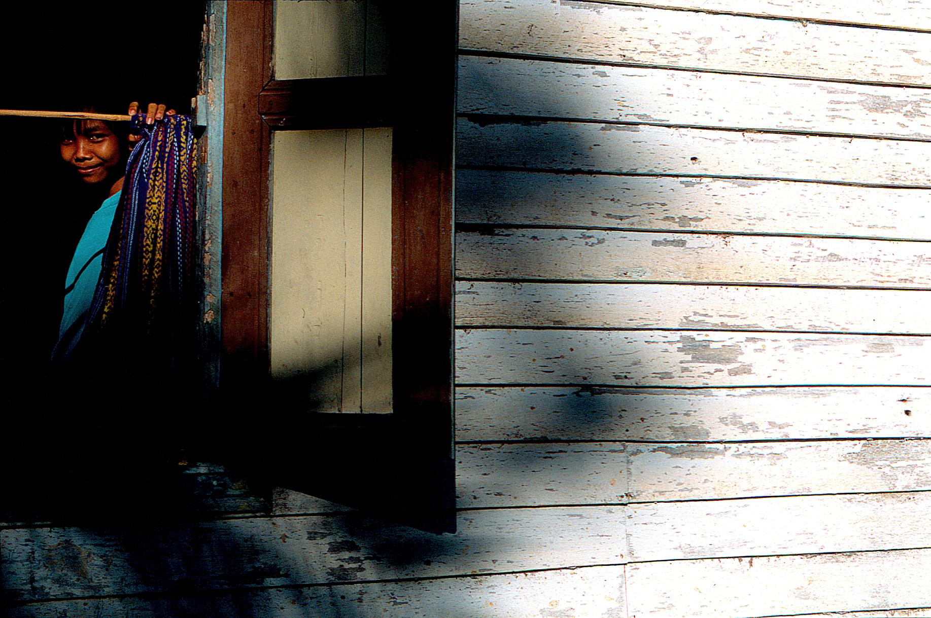 CT_012_Borneo Woman in Window.jpg
