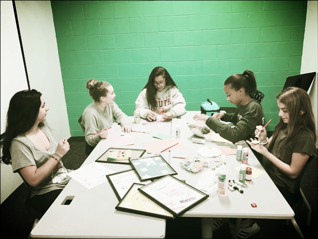 """Students painting """"Identity Stones"""" as part of their 6th and 7th grade Girl's Group.This group met twice a week and focused on identity (social, gender, ethnic, religious, etc.) and the transition from middle to high school."""