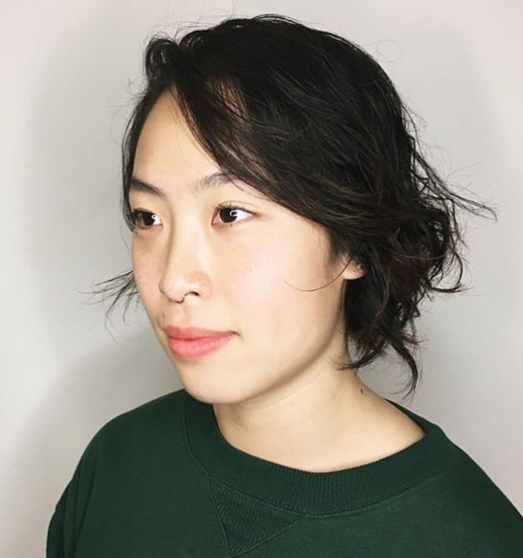 "This cut by our stylist Rori is a perfect example of how ""messy"" can look modern. If you have fine hair, the right cut can help you get tousled texture and volume. Add a bit of mousse, then scrunch and go."