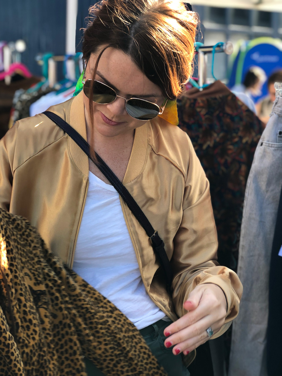 Still considering every angle of this velour jacket with both leopard print and leopards on it.