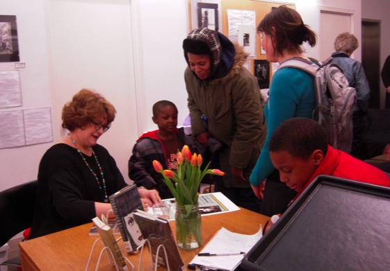 Poet April Bernard signing books