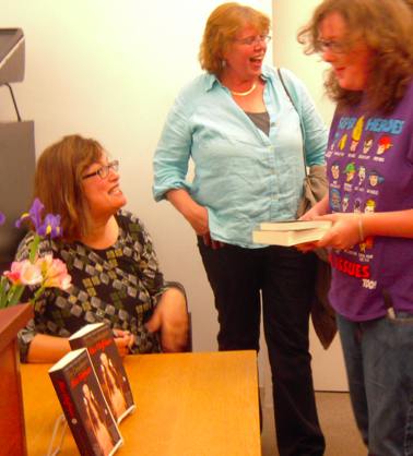 Alice Hoffman signing books at the library