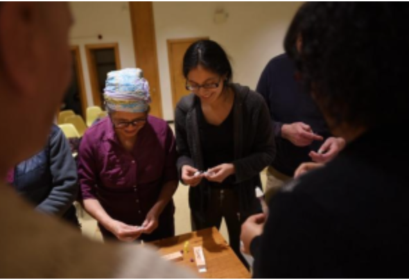 Volunteers at the Roslindale branch of the BPL practicing overdose prevention and Narcan use