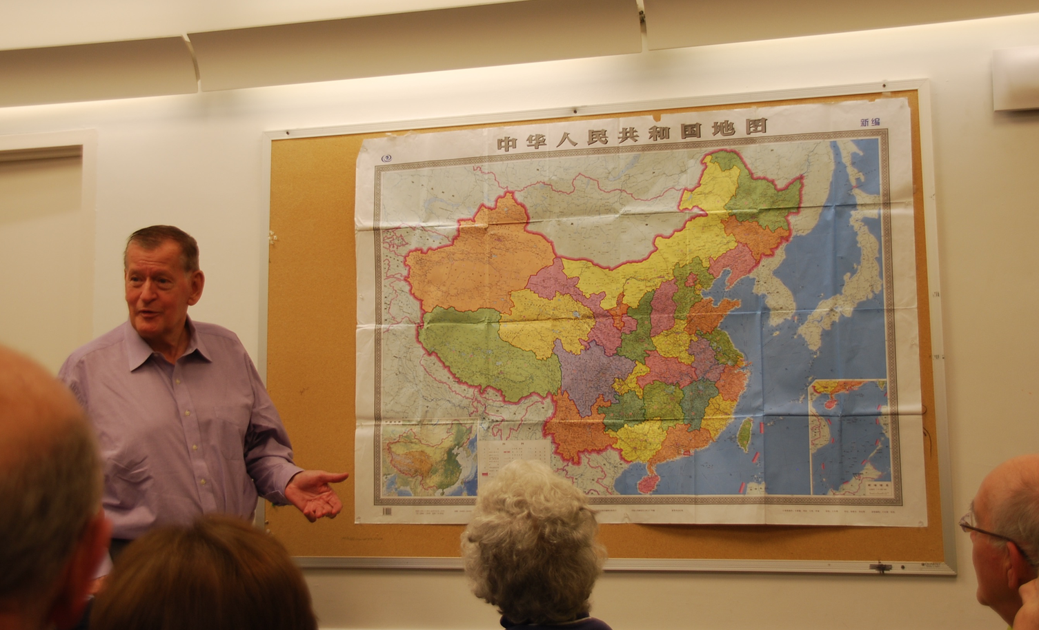 China expert and South End resident, Ross Terrill, hung up a map of China to explain why it feels surrounded by countries that are not its friends.