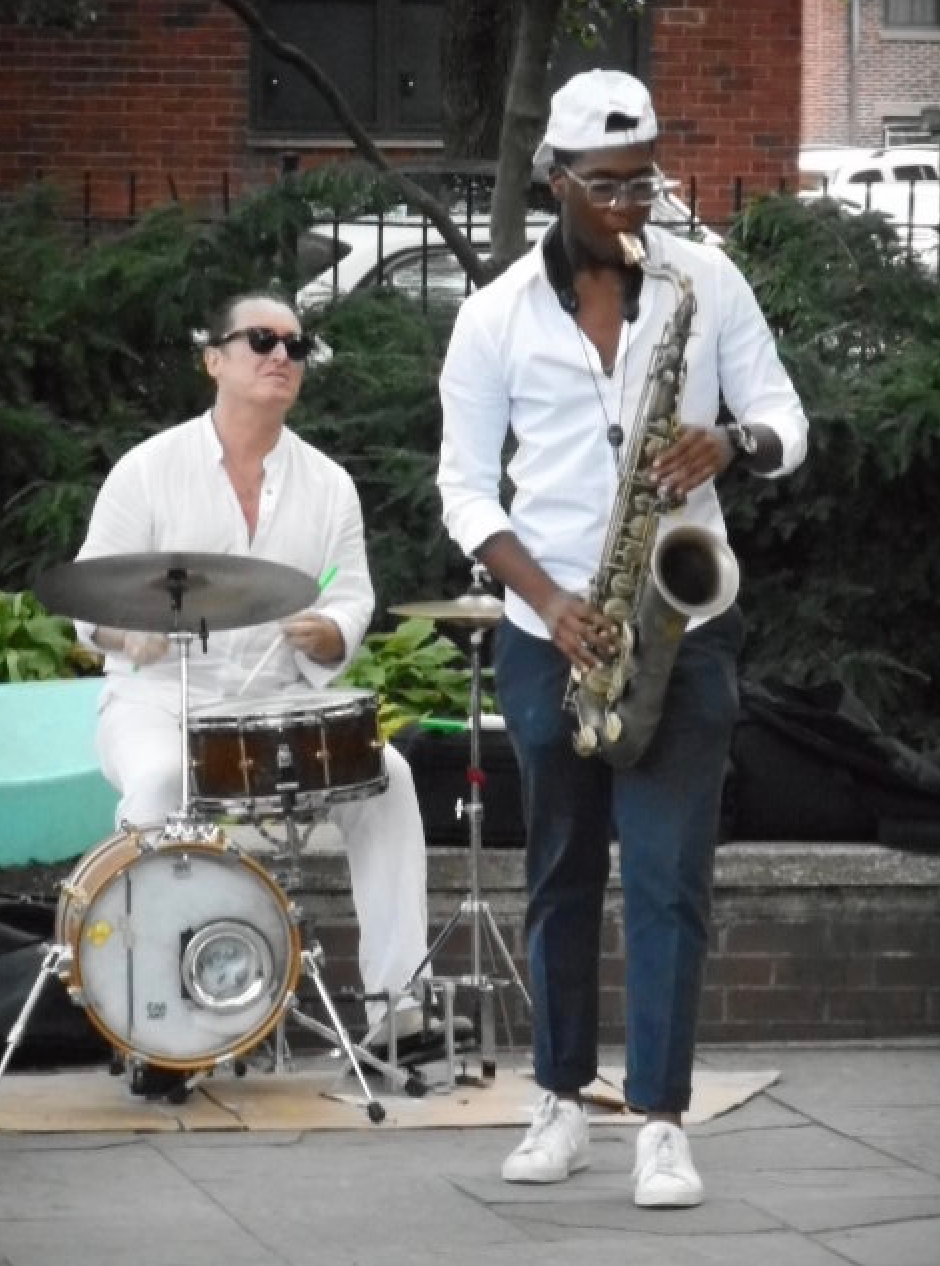 Benny Benson drumming with tenor-sax player Yesseh Ali