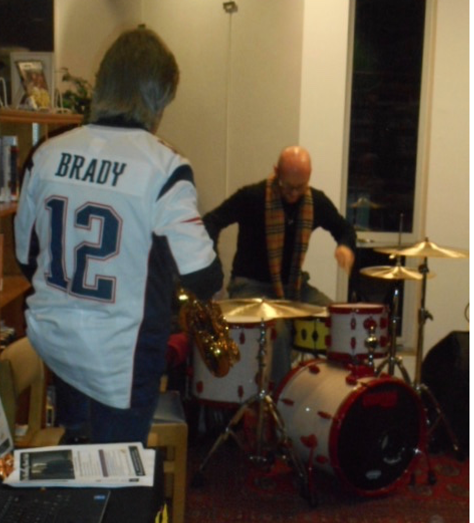Pat Loomis (from the back) watching drummer Zeke Martin throw himself into it