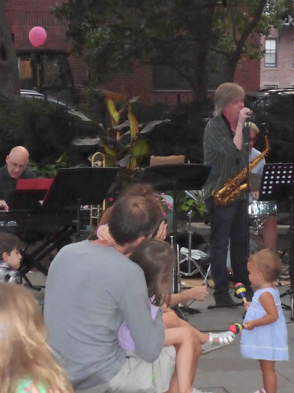 Parents and children, some with their own instruments, enjoyed the concert. Steven Higgs on keyboard in the back.