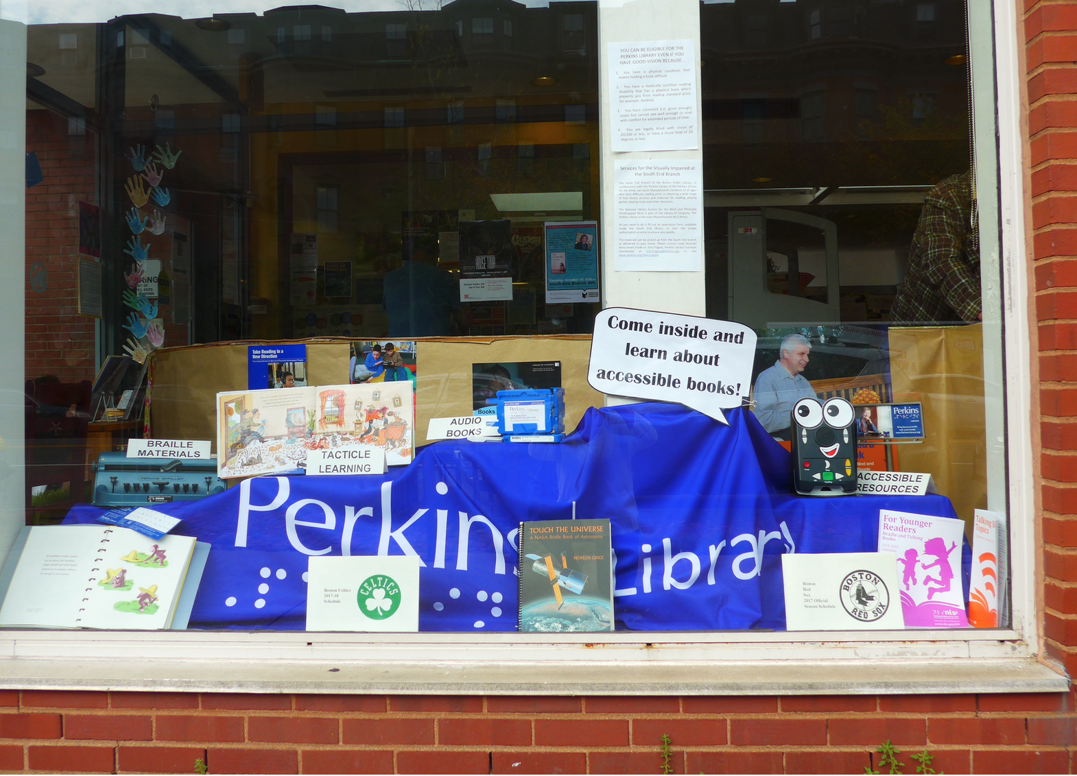 The Tremont Street window installation of services and materials offered by the Perkins Braille and Talking Books Library