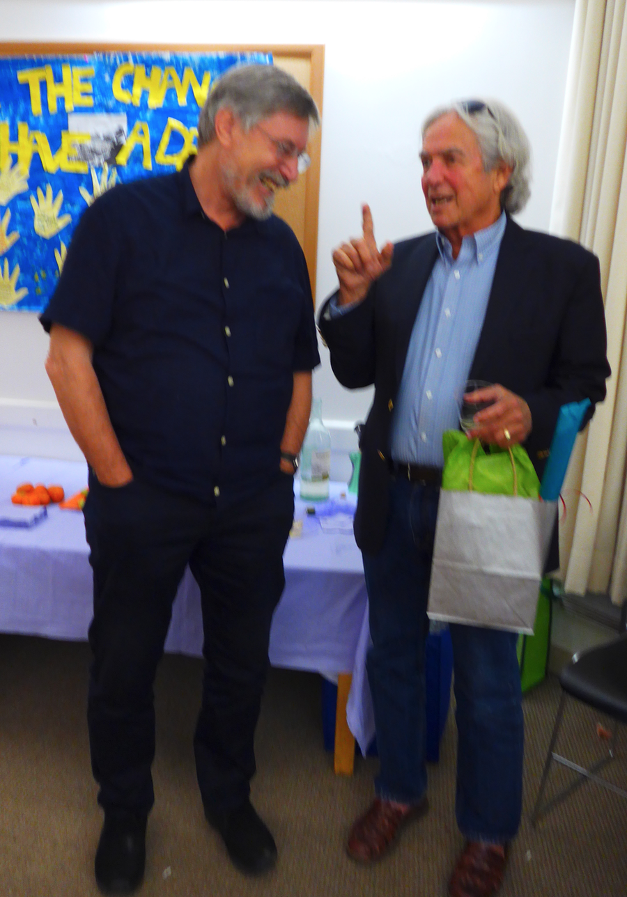 Bessel van der Kolk, psychiatrist and Medical Director of the Boston Trauma Center, and Ed Tronick,Distinguished Professor Director of the Child Development Unit at UMass,Boston, chatting at the South End Writes event