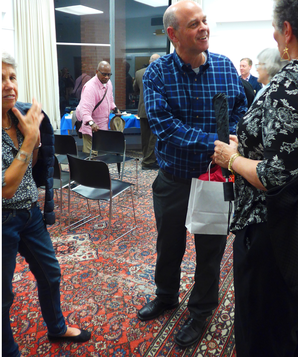 Conductor Gil Rose greeting opera enthusiasts at the South End library in October