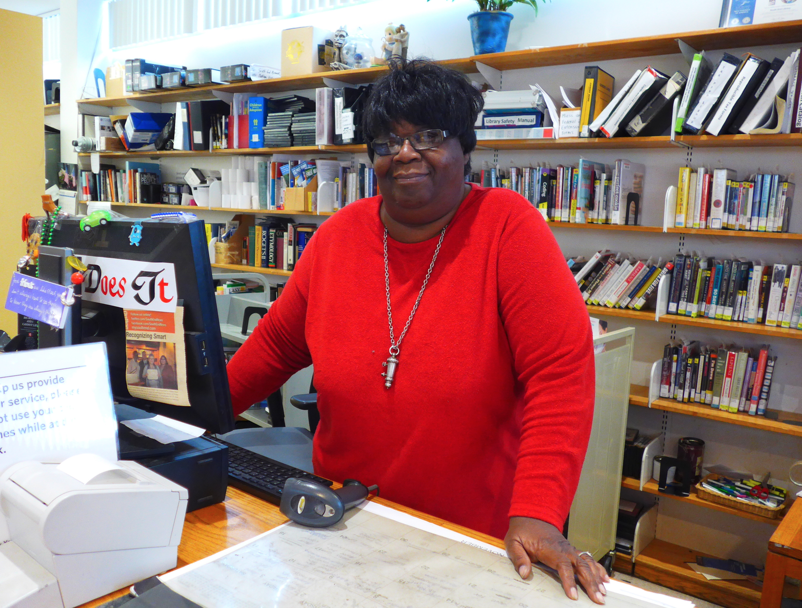As she is known to hundreds, if not thousands, Deborah Madrey behind the circulation desk of the South End branch of the Boston Public Library